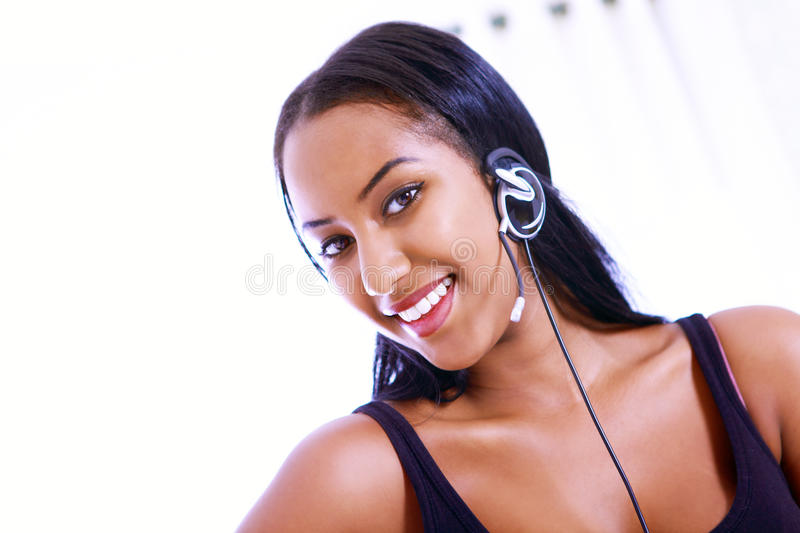 Smiling receptionist. Or call center worker royalty free stock photos