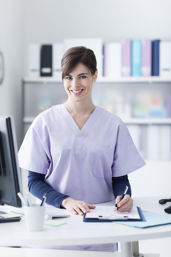 Smiling receptionist at the clinic royalty free stock images