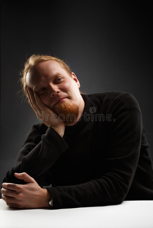 Smiling red-haired man stock photos