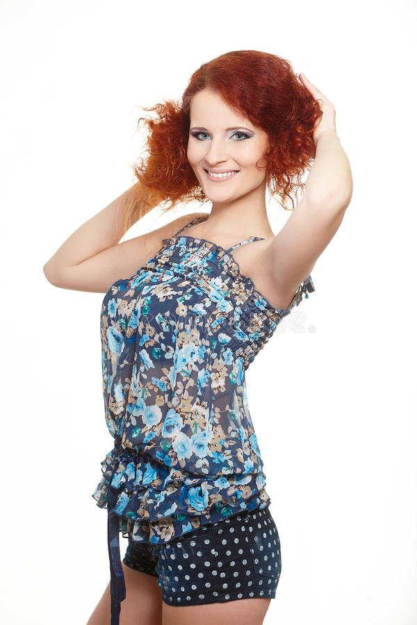 Smiling redhead ginger woman in summer dress