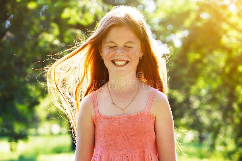 Smiling redhead girl royalty free stock photos