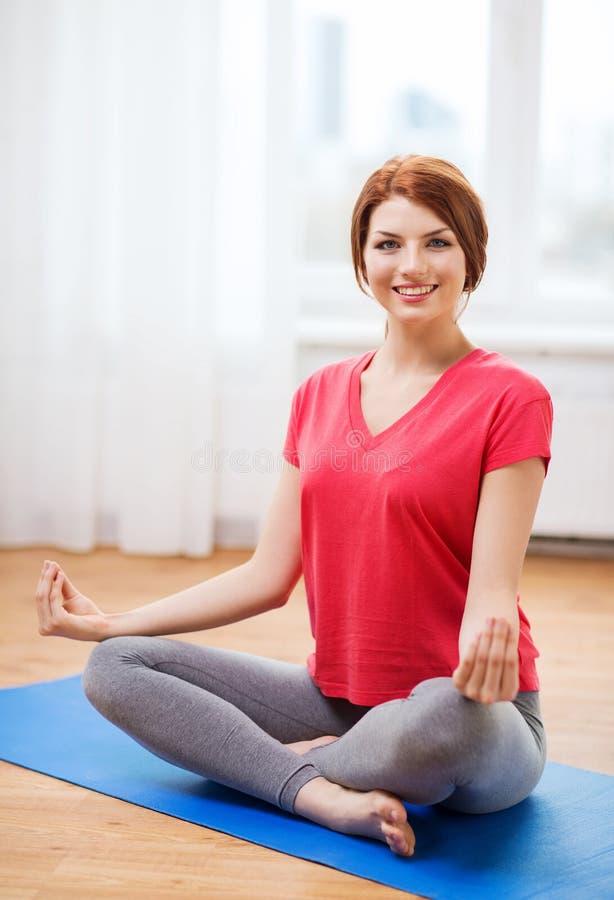 Download Smiling Redhead Teenager Meditating At Home Stock Image - Image: 40042247