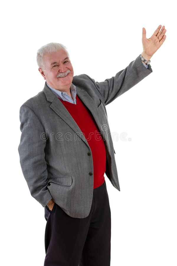 Smiling relaxed happy senior man with raised arm stock photo