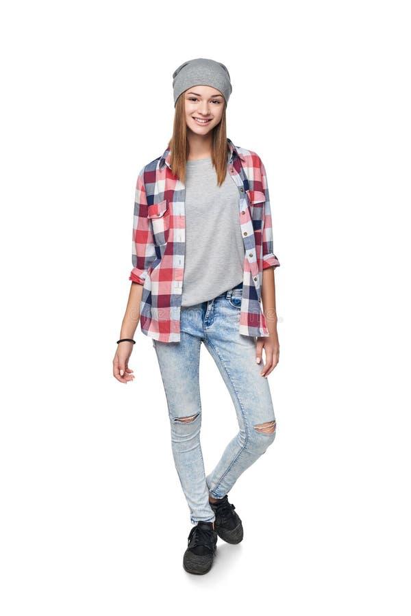 Smiling relaxed teen girl standing in full length stock images