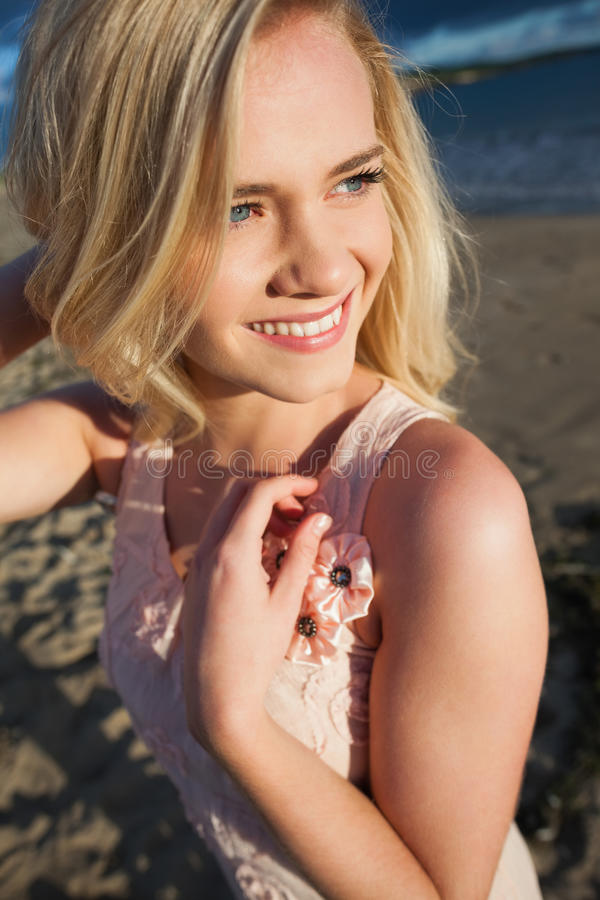 Smiling Relaxed Young Blond Looking Away At Beach Stock Photos