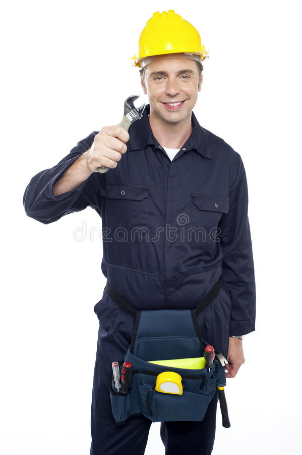 Download Smiling Repairman Holding Out Screwdriver Stock Photo - Image of professional, background: 26567214