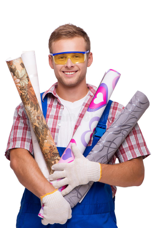 Smiling repairman with wallpaper. Young smiling repairman with eyewear holding wallpaper and looking at the camera, isolated on white stock photography
