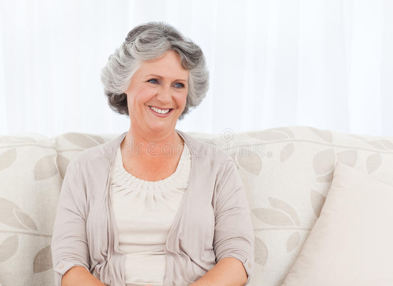 Smiling retired woman royalty free stock image