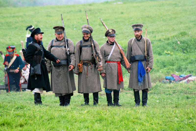 Smiling and sad Russian army soldiers-reenactors royalty free stock photo