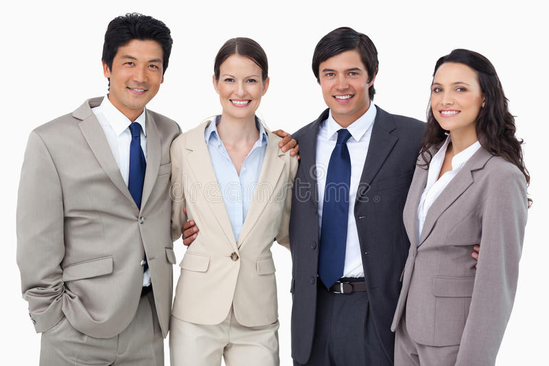 Smiling salespeople standing together stock photos