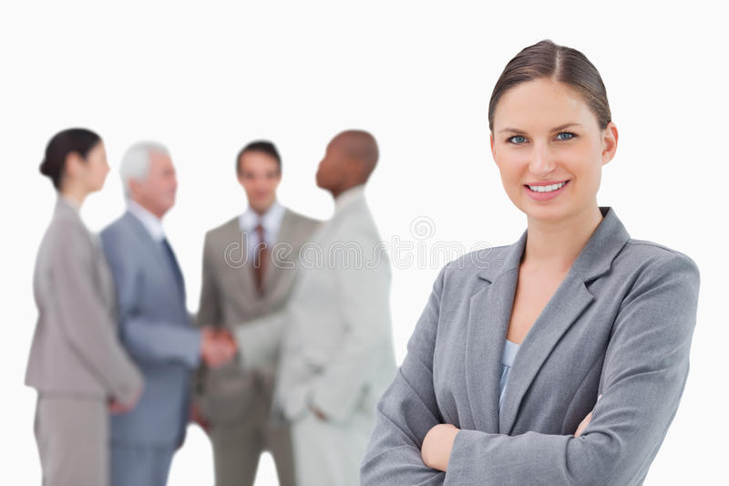 Download Smiling Saleswoman With Folded Arms And Colleagues Behind Her Stock Photo - Image: 22859014