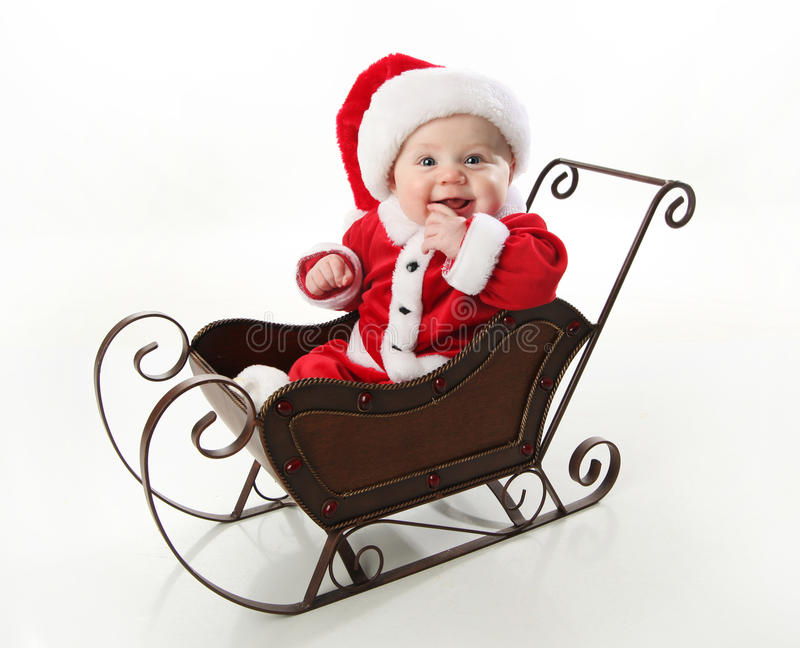 Download Smiling Santa Baby Sitting In A Sleigh Stock Photo - Image: 17504580