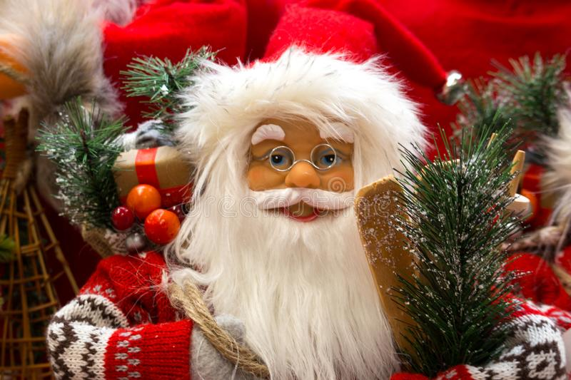 Smiling Santa Claus with gifts and new year`s tree close up. Merry Christmas and Happy New Year concept. Winter holidays. Smiling Santa Claus with gifts and new stock photos