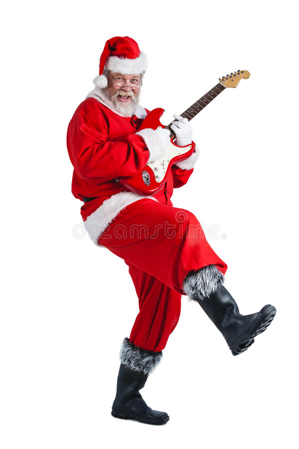 Smiling santa claus playing a guitar royalty free stock photos