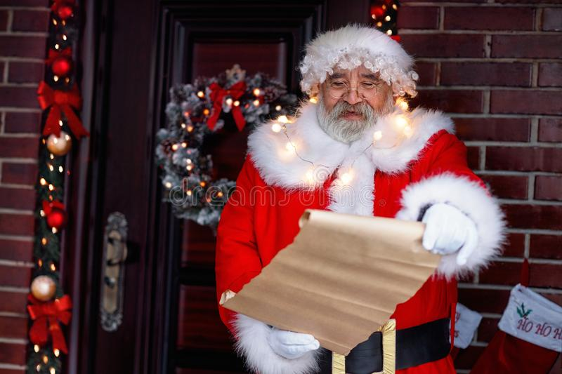Smiling Santa holding scroll paper royalty free stock image