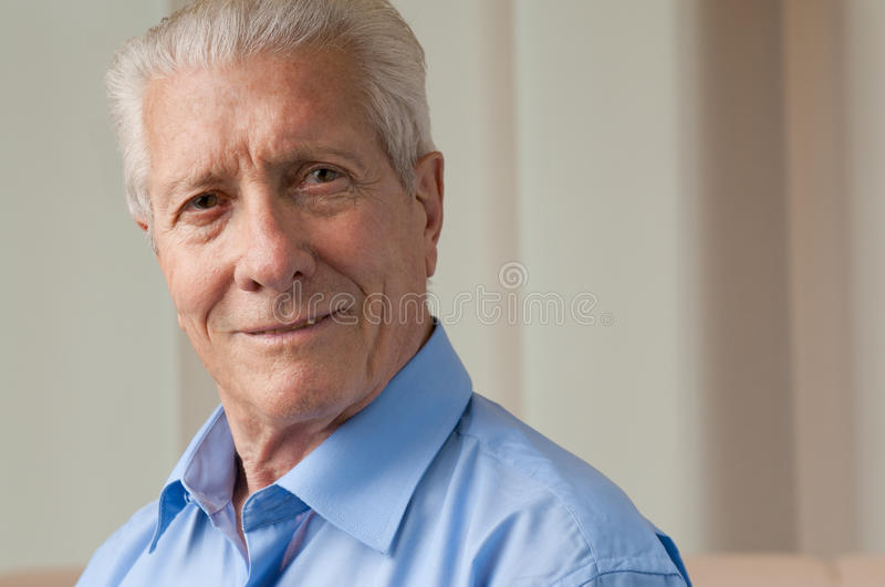 Smiling satisfied aged man stock photos