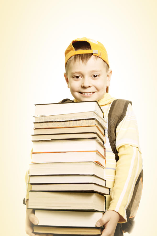 Smiling schoolboy with books stock images