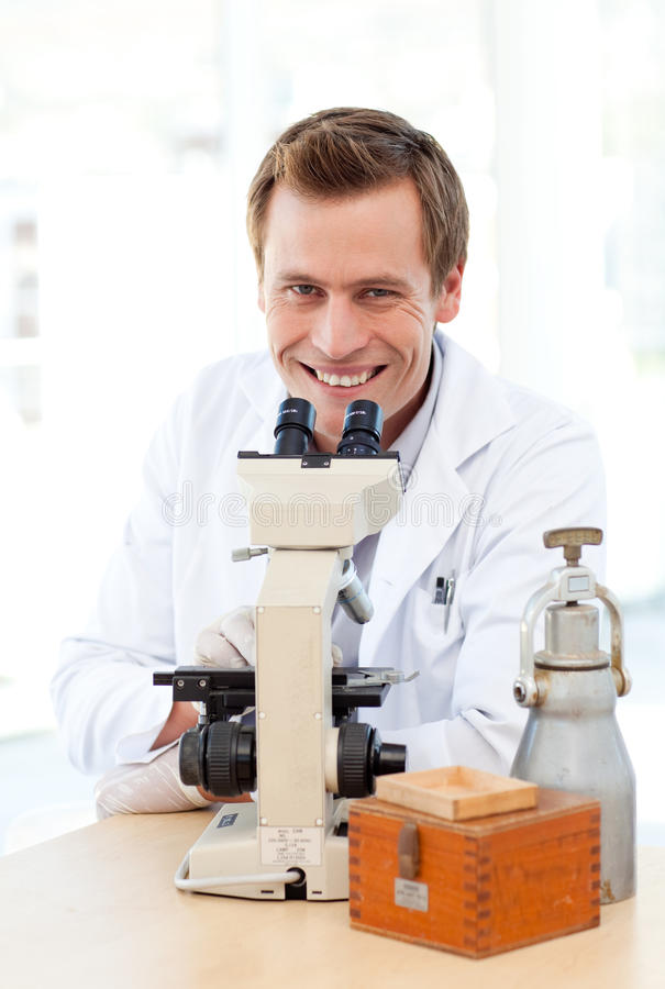 Download Smiling Scientist Looking Through A Microscope Stock Photo - Image: 9756788