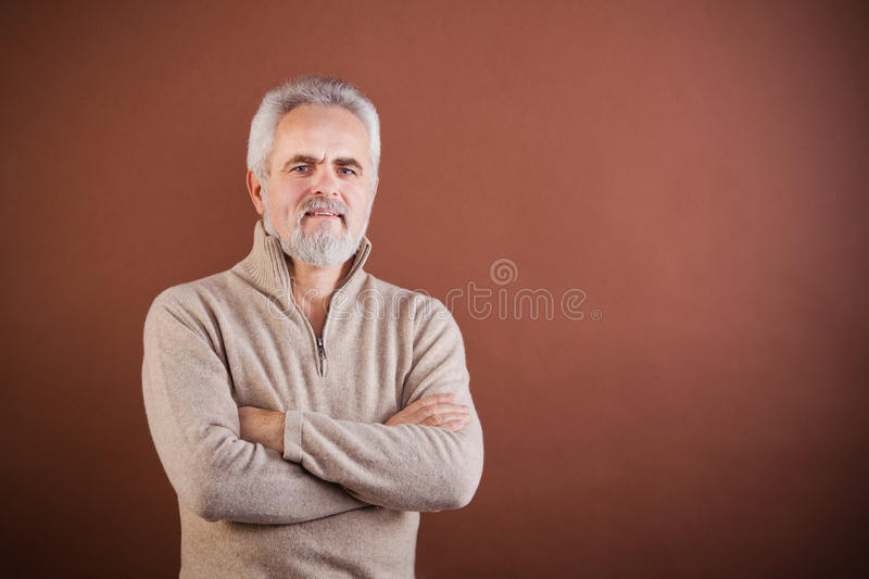 Smiling Senior With Arms Crossed Stock Image