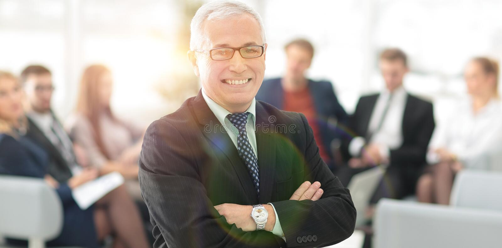 Smiling senior boss in the background of the office. Photo with copy space royalty free stock images