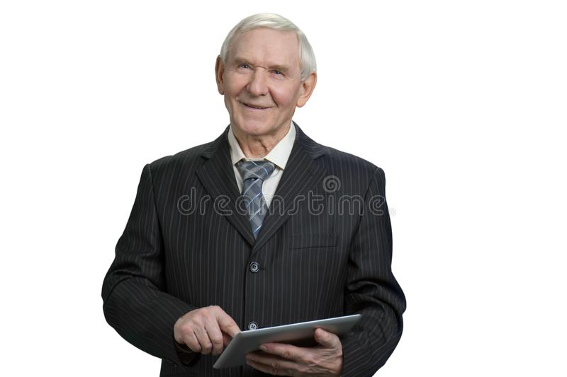 Smiling senior business man tapping tablet. stock photos
