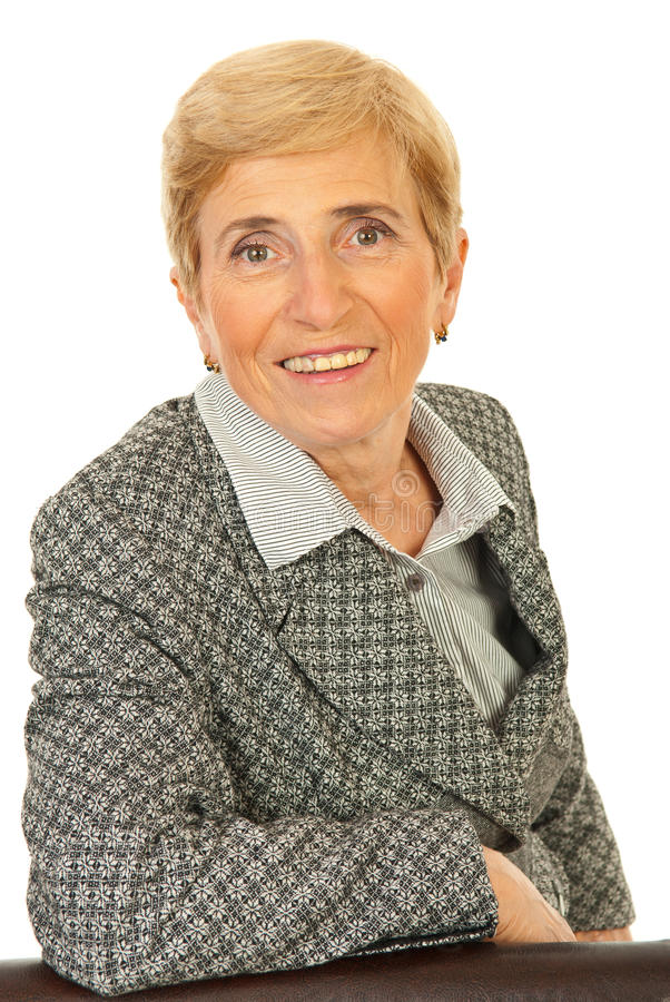 Smiling senior business woman stock images