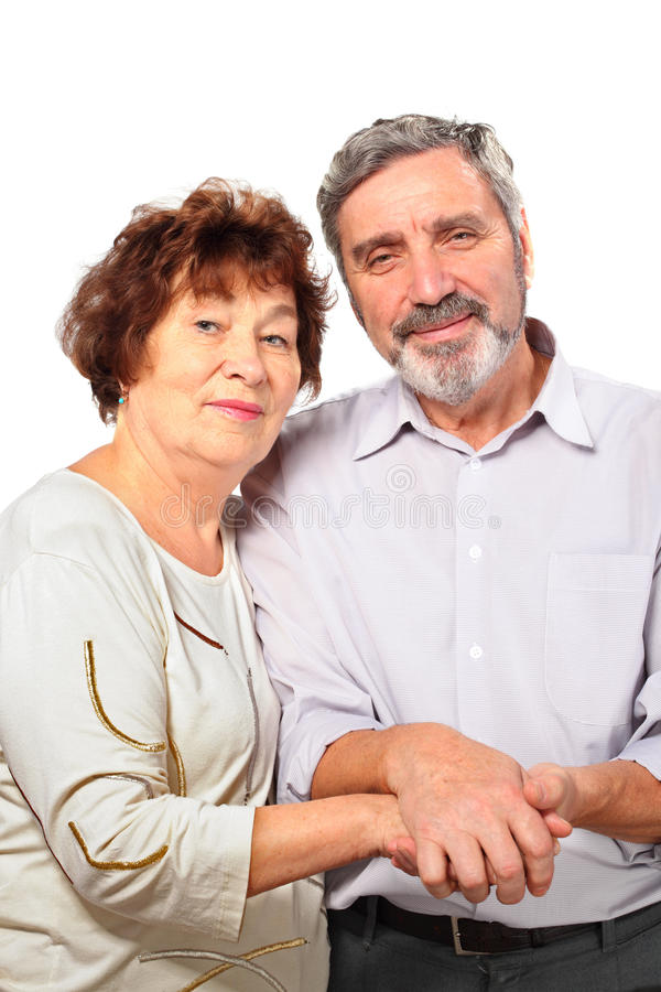 Smiling senior couple hold for hands stock image