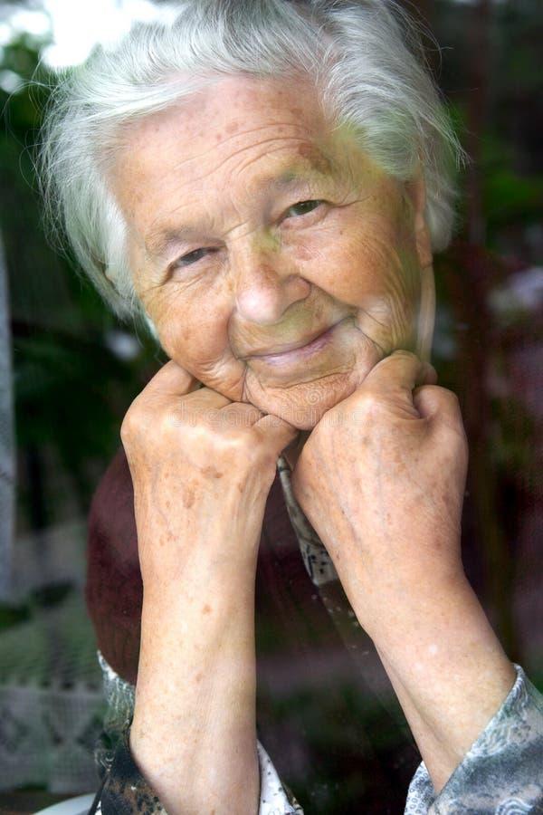 Smiling senior lady stock photo