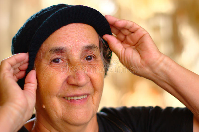 Smiling Senior Lady With Cap stock image