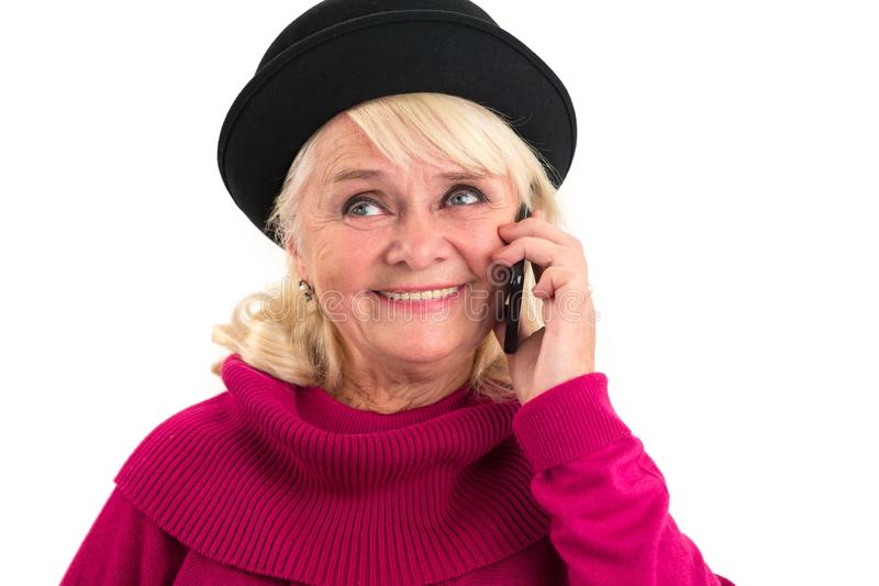 Smiling senior lady holding cellphone. royalty free stock photography