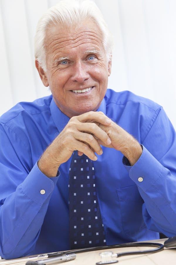 Smiling Senior Male Doctor Stock Photo