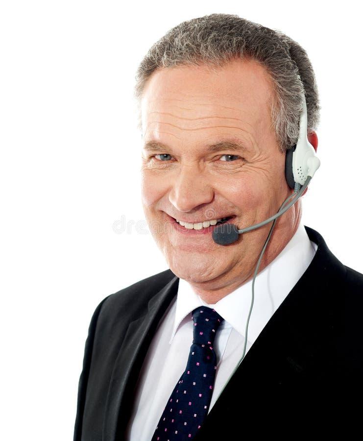 Smiling senior male operator. Closeup shot stock photo