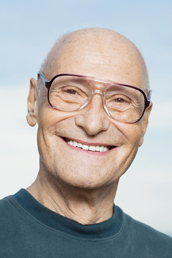 Smiling senior man stock photos