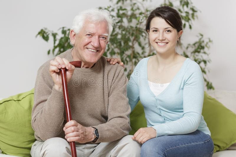 Smiling senior man holding can royalty free stock photography