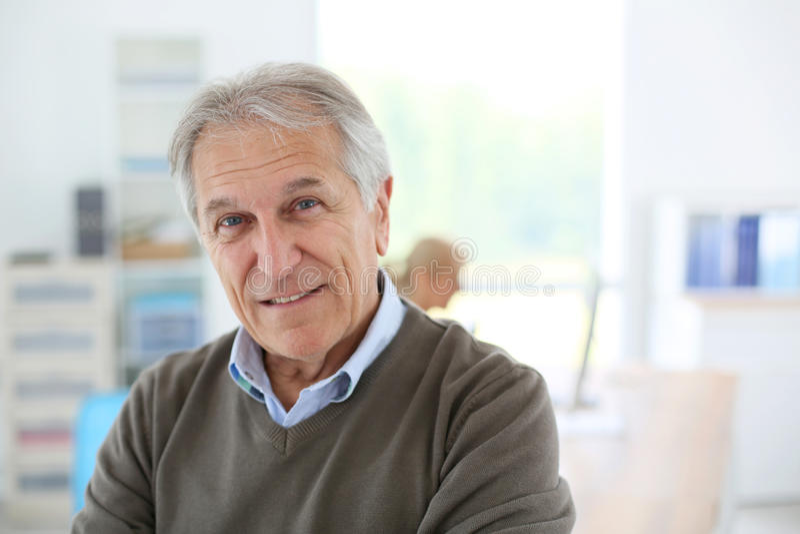 Smiling senior man at office royalty free stock images