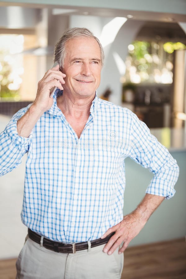 Smiling senior man talking on mobile phone stock images