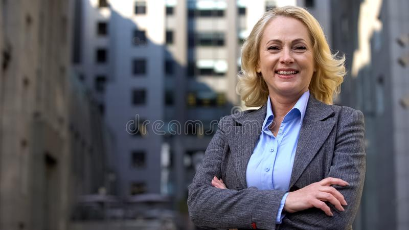 Smiling senior manager in business suit looking in camera, career motivation stock photos