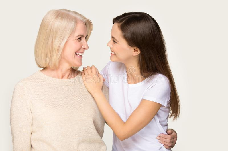 Smiling senior mother and grownup daughter hugging royalty free stock photo