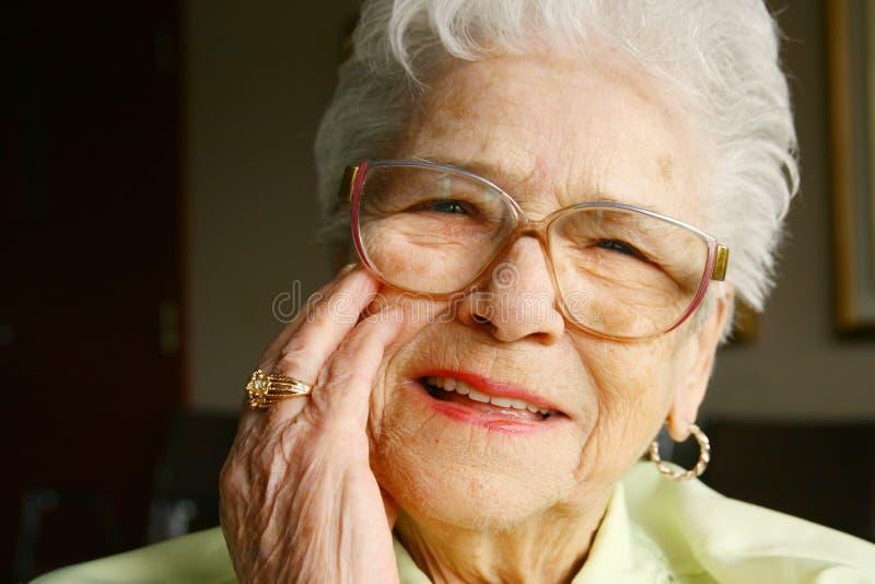Smiling senior woman. Elderly smiling woman in a elderly center stock photo