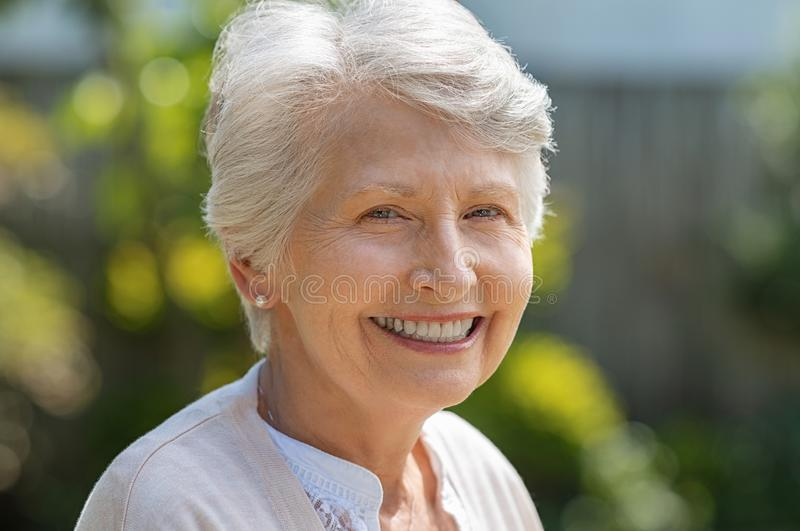 Smiling senior woman stock images