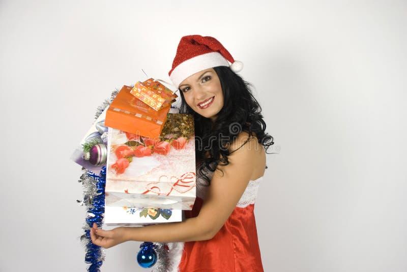 Smiling sensual Santa helper woman royalty free stock images