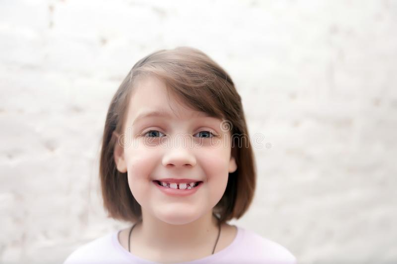 Smiling seven year old girl on   white stock image