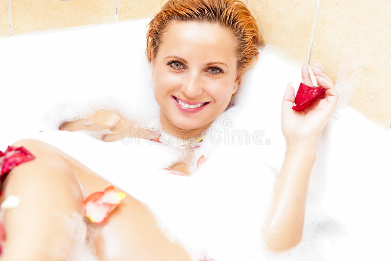 Smiling Caucasian Woman Relaxing in Bath royalty free stock photo