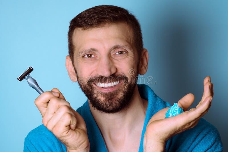 Smiling shaving man royalty free stock photo