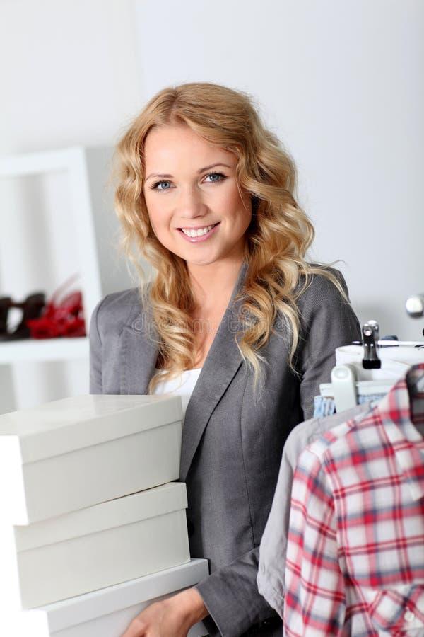 Smiling shop tender stock image