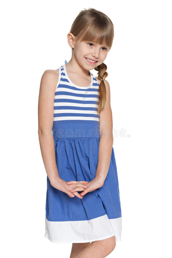 Smiling shy young girl stock images