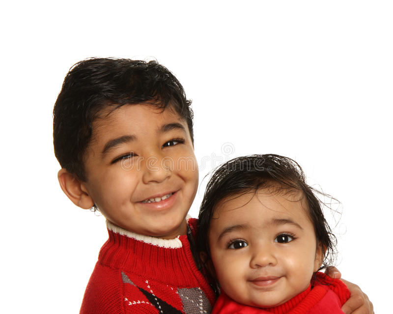 Smiling Siblings - Brother Holding Baby Sister. Smiling Siblings - Older Brother Holding Baby Sister, Isolated, White stock photo