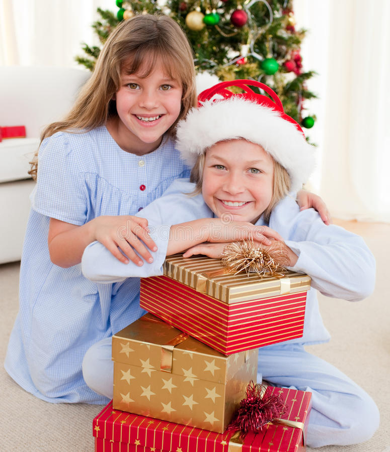 Download Smiling Siblings Holding Christmas Gifts Royalty Free Stock Image - Image: 11943556