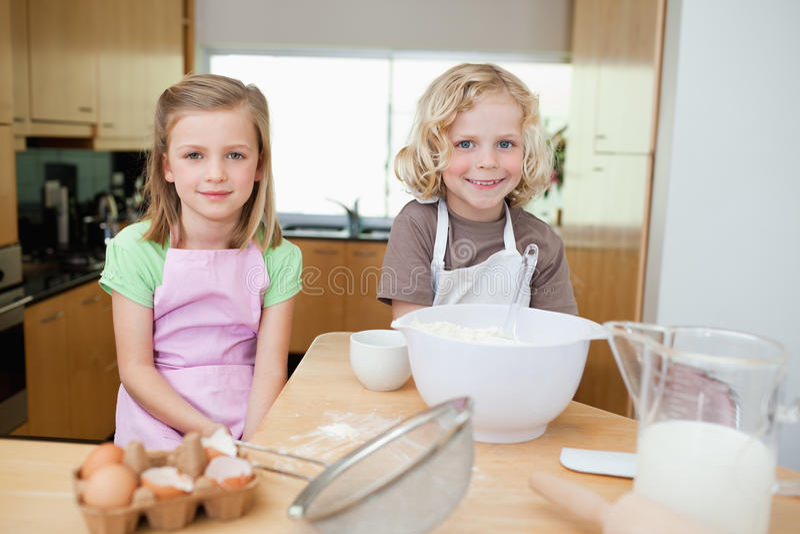 Download Smiling Siblings Preparing Dough Stock Photo - Image: 22661306