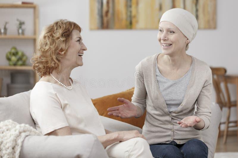 Smiling sick woman enjoying meeting royalty free stock photo